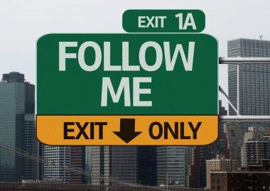Follow Me road sign