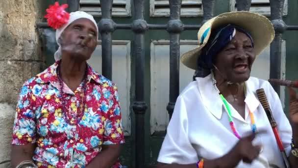 Cubans smoking cigars