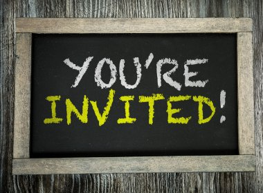 You're Invited! on chalkboard