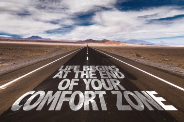 Life Begins at the End of Comfort Zone on desert road