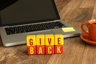 Give Back written on cubes