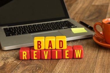 Bad Review written on cubes