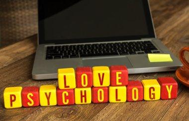 Love Psychology written on cubes