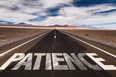 Patience written on road
