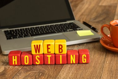 Web Hosting written on cubes