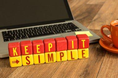 Keep It Simple written on cubes