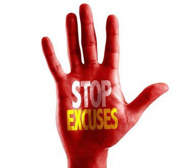 Stop Excuses written on hand