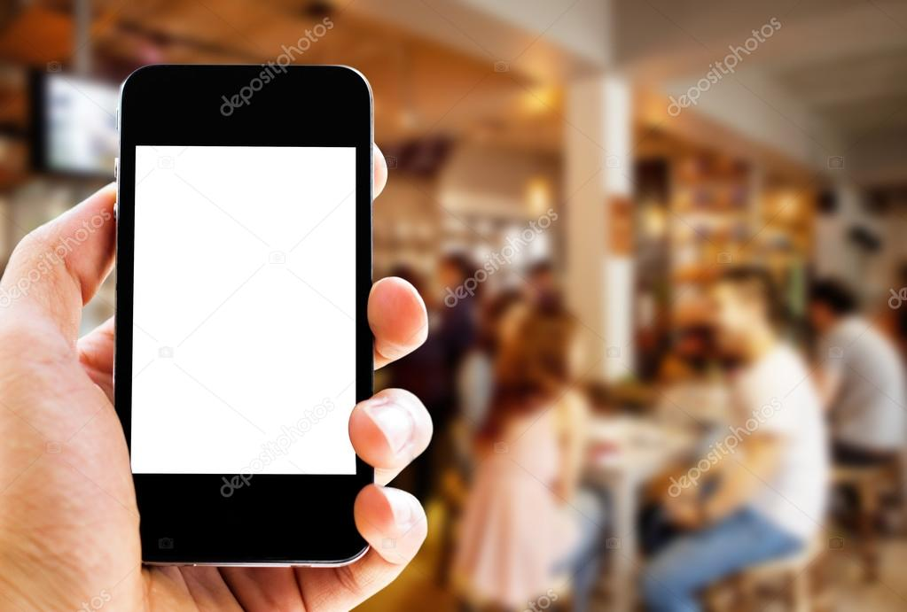hand holding phone with blurred cafe  background