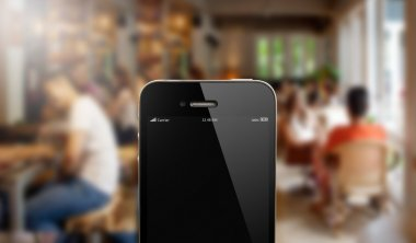 close up smart phone against blur people in cafe background