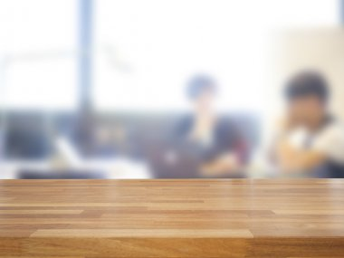 Empty wooden table and blurred business people background