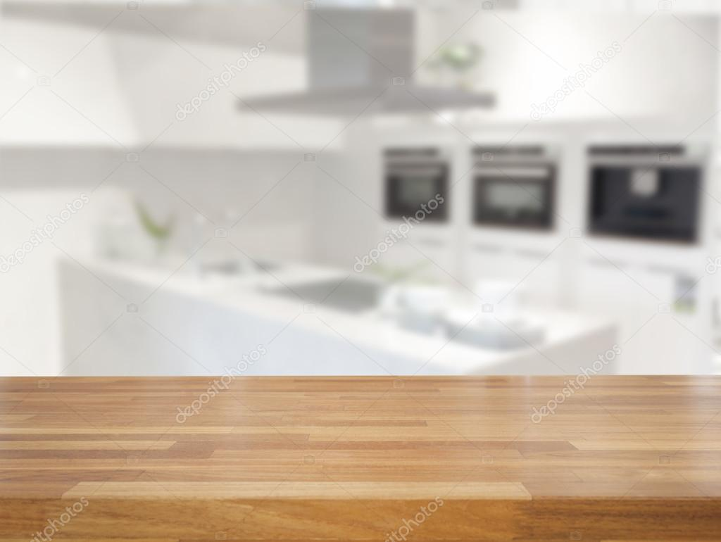 Empty wooden table and blurred kitchen background stock for Kichan image
