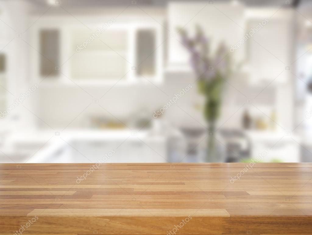 Empty wooden table and blurred kitchen background stock for Wooden tabletop kitchen