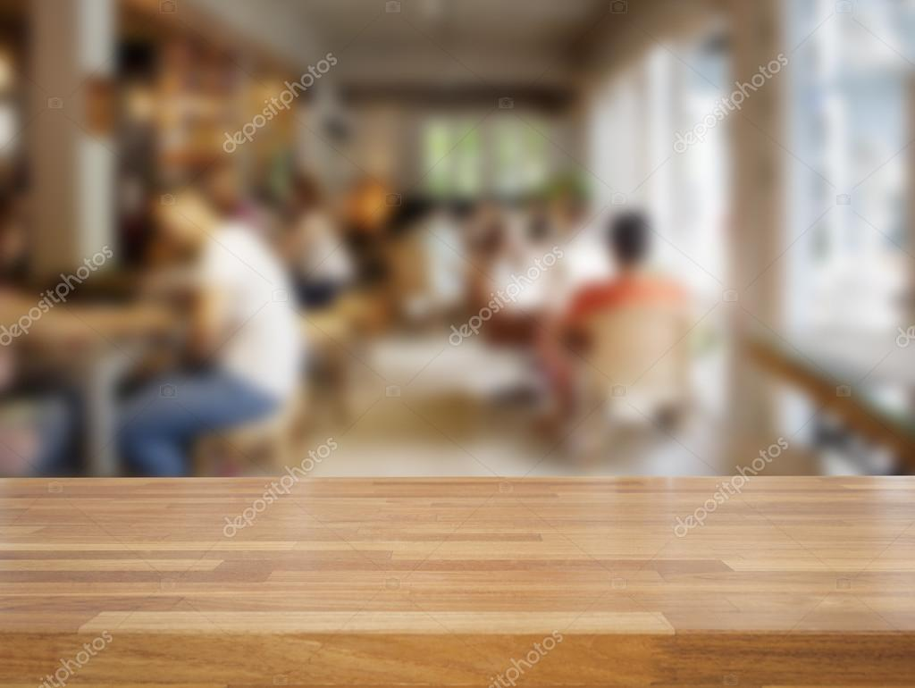 Empty wood table and blurred living room background stock photo - Empty Wooden Table And Blurred People In Cafe Background Stock Photo 74210299