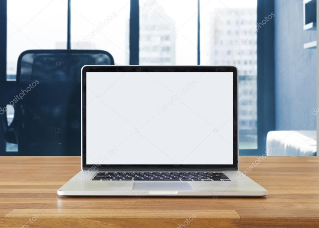 Laptop on table, on office background