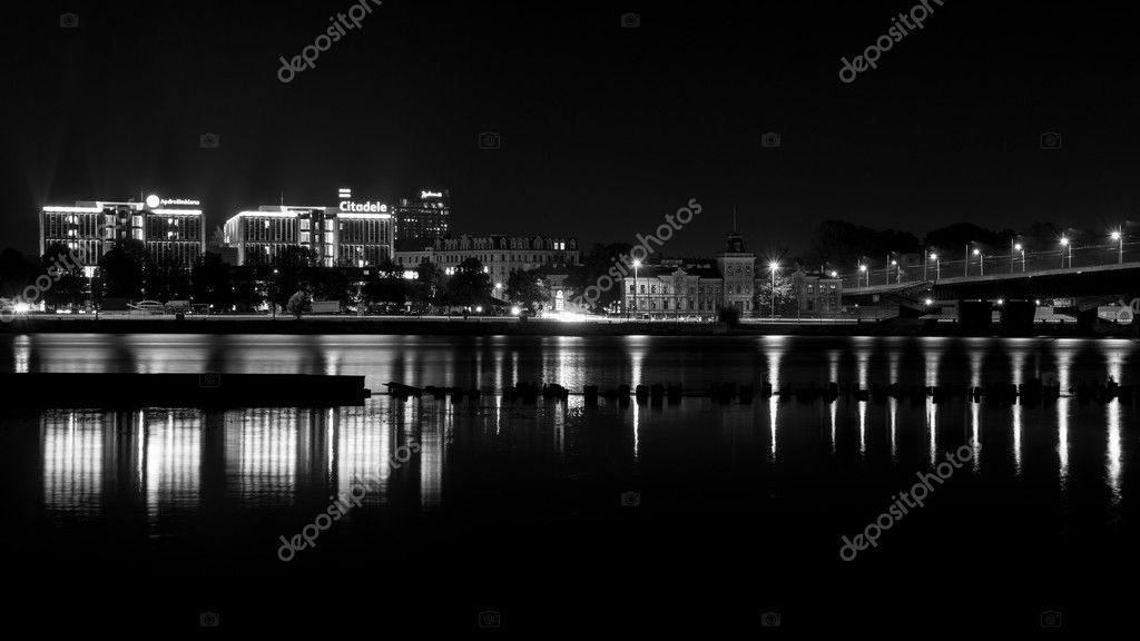 City light reflections over water at the night