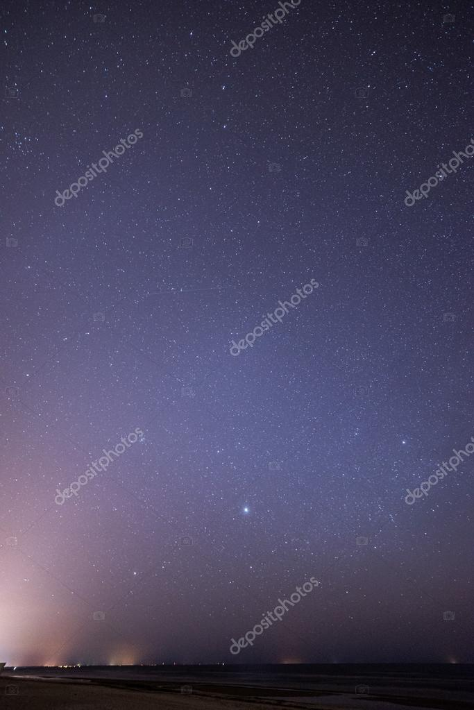 night sky with stars on the beach. space view.