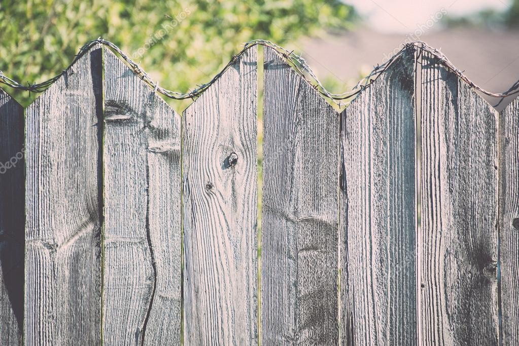 Old Wooden Fence With Barbed Wire On Top. Vintage. U2014 Stock Photo