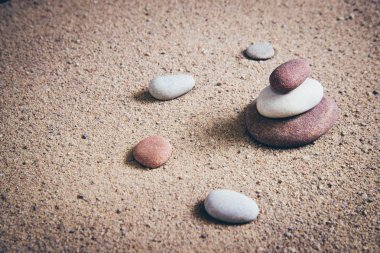 Zen garden sand waves and rock sculptures. Vintage photography effect. Retro grainy color film look. stock vector