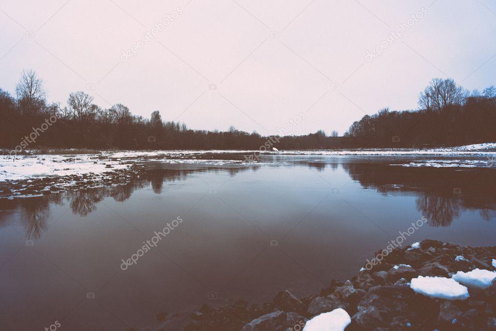 cold winter landscape with frozen river. retro vintage polaroid