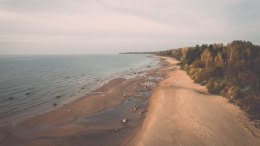 aerial view to the Shoreline of Baltic sea beach with rocks and