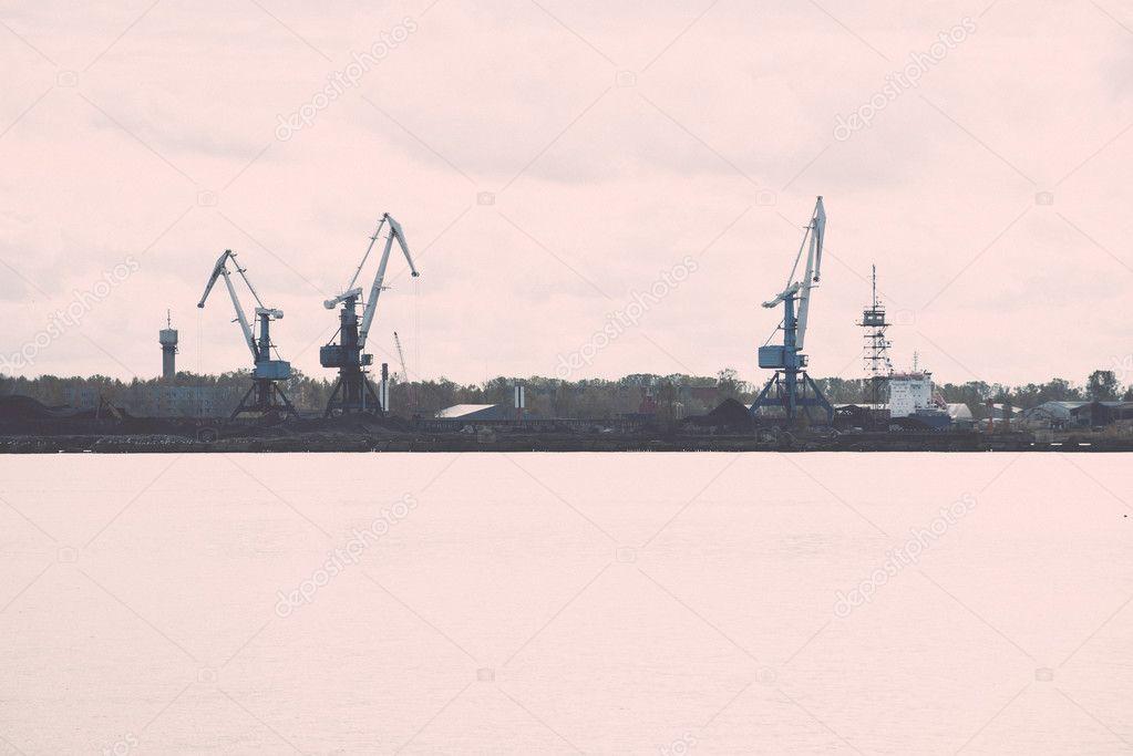 8ccb6ece246 Cargo dock and cargo ships in seaport in Riga. latvia - retro