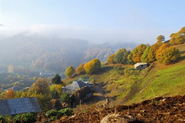 Autumn landscape with a house in the mountain village