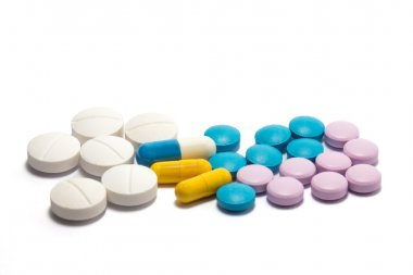 Diferent tablets pills heap mix on white isolated background