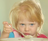 girl eats cottage cheese for Breakfast