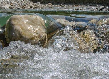 Stones over a running stream