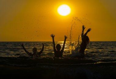 group of friends splashing water