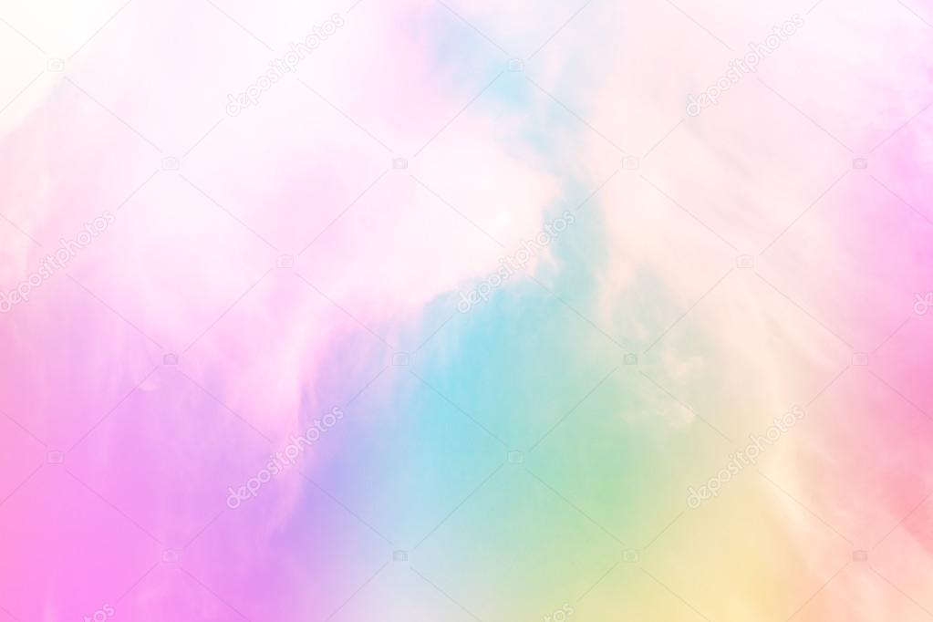 Soft rainbow filter over sky and clouds background.