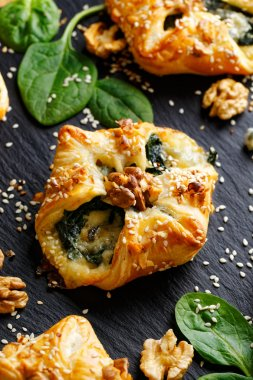 Spinach puff with addition of Gorgonzola cheese, walnuts and sesame seeds