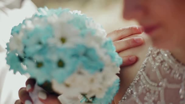 Beautiful wedding bouquet with white and blue flowers