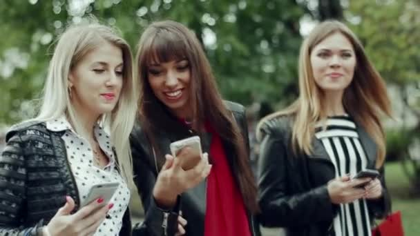 Girl with phones are on the street