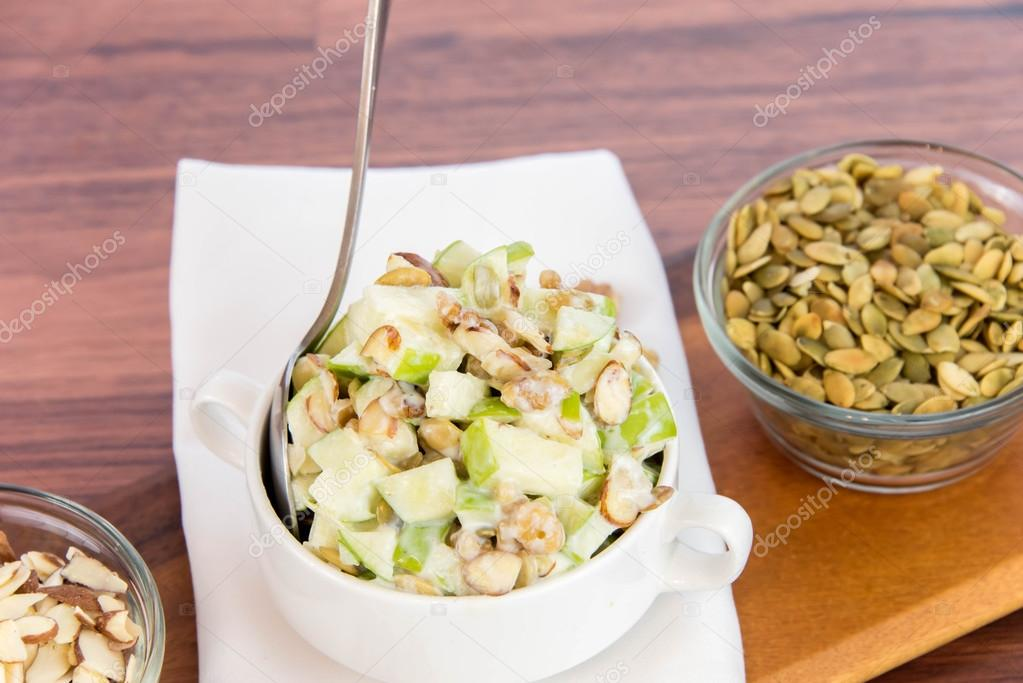 apple salad with almonds, walnuts and pumpkin seeds