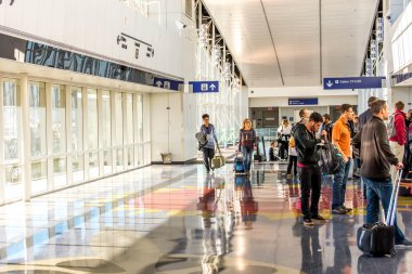 DFW airport - passengers in the Skylink station