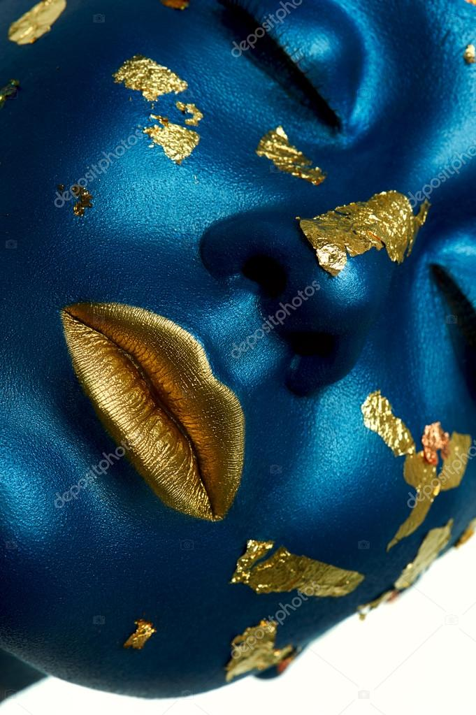 Blue beauty Face with Gold lips.