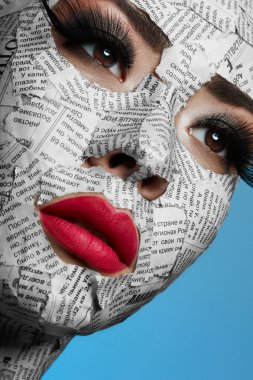 Model with Newspaper on Face