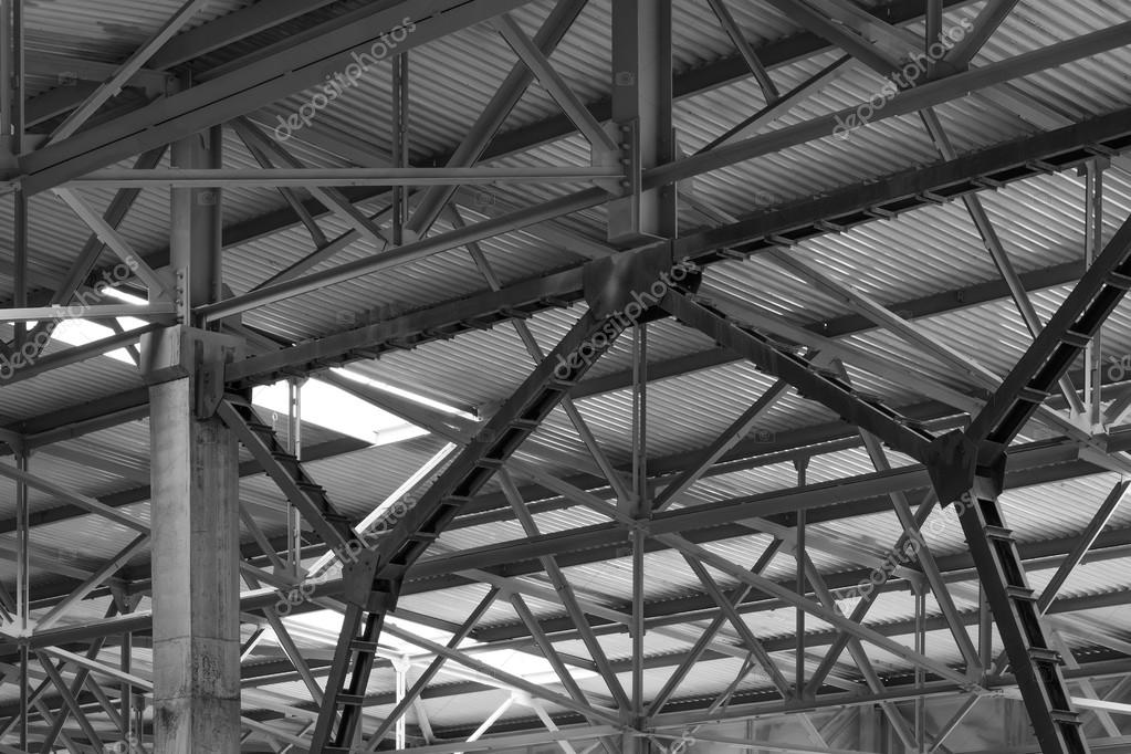 metal framework of the roof of industrial premises in the enterprise inside view in black and white