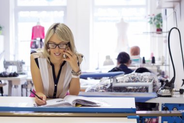 Self employed woman taking customer orders by phone