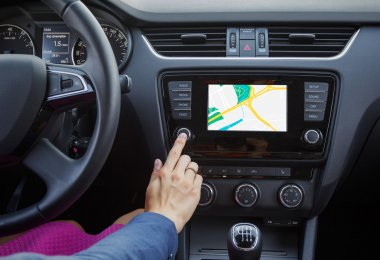 Woman using navigation system while driving a car