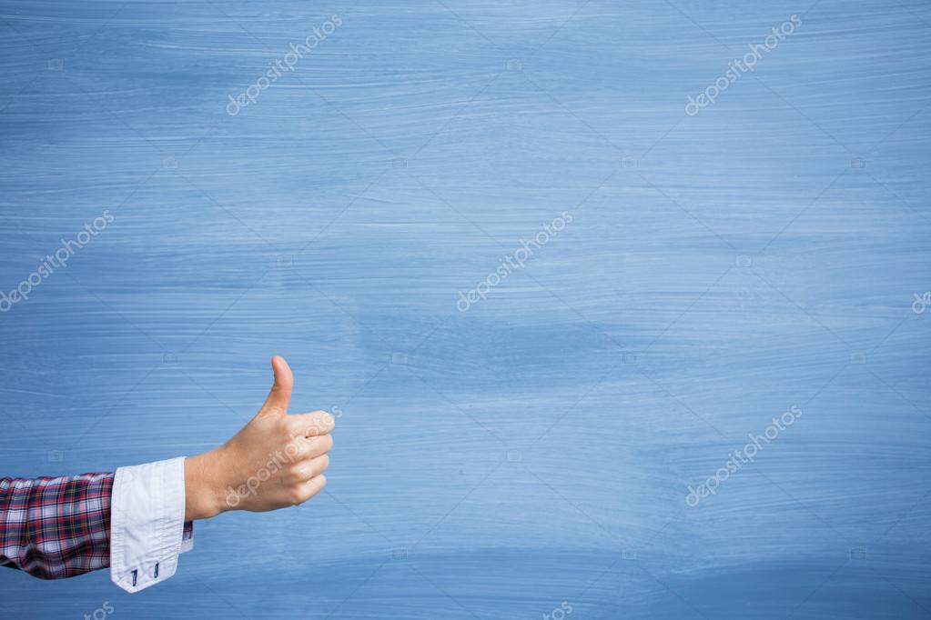 Hand showing thumbs up gesture