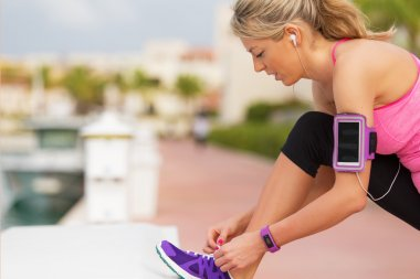 Active girl tying trainers before running exercise outdoors