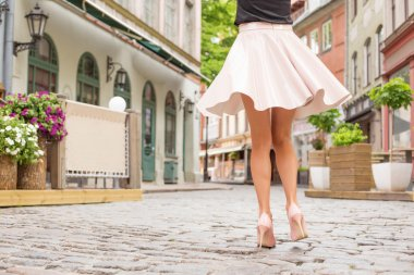 Elegant lady with beautiful legs