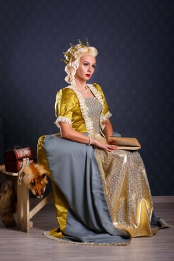 Picture of beautiful haughty queen in royal dress