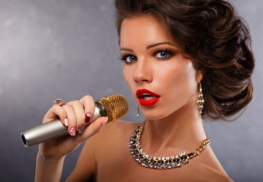 Singing Woman with Microphone.Glamour Singer Girl Portrait. Karaoke Song