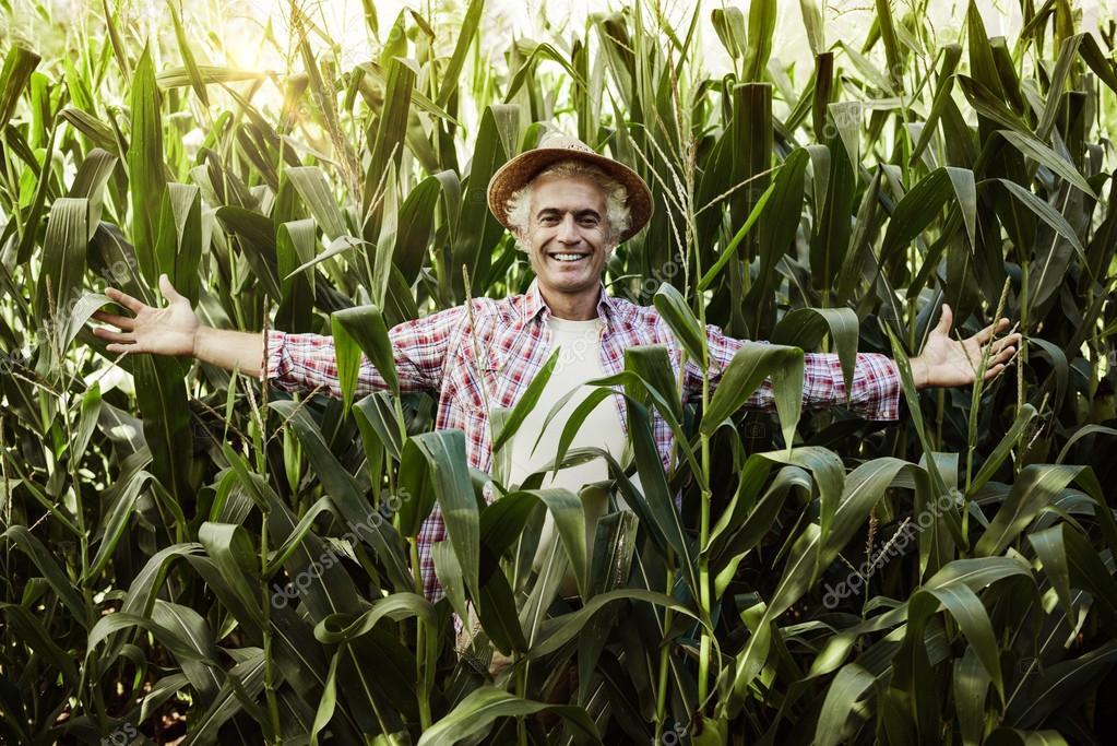 Happy farmer posing in the field
