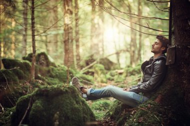 Young man resting in the woods