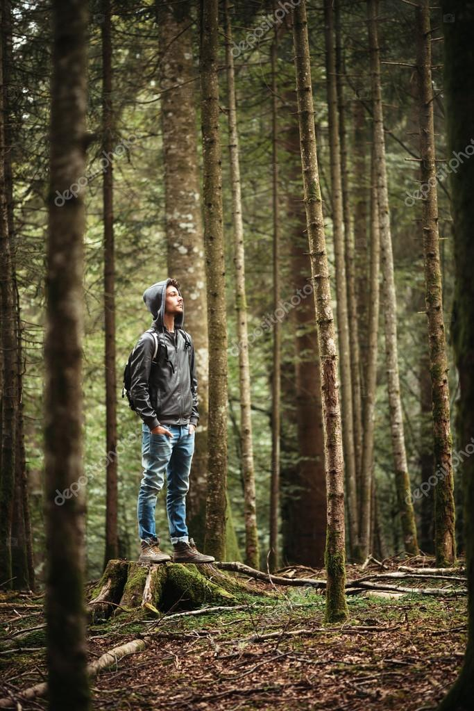 Hooded man posing in the forest