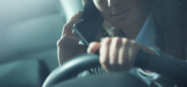 Young woman calling while driving